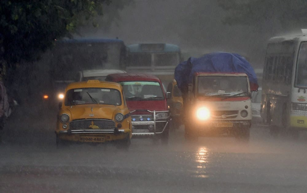 A slow moving traffic due to heavy rainfall in Kolkata.