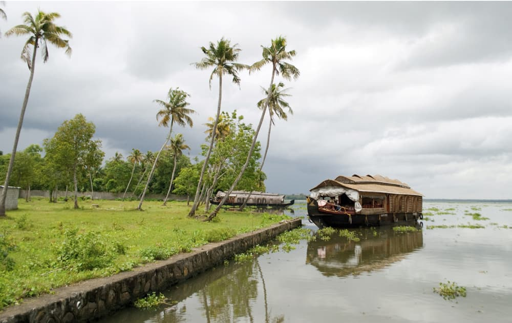 Houseboat in backwaters on a cloudy day
