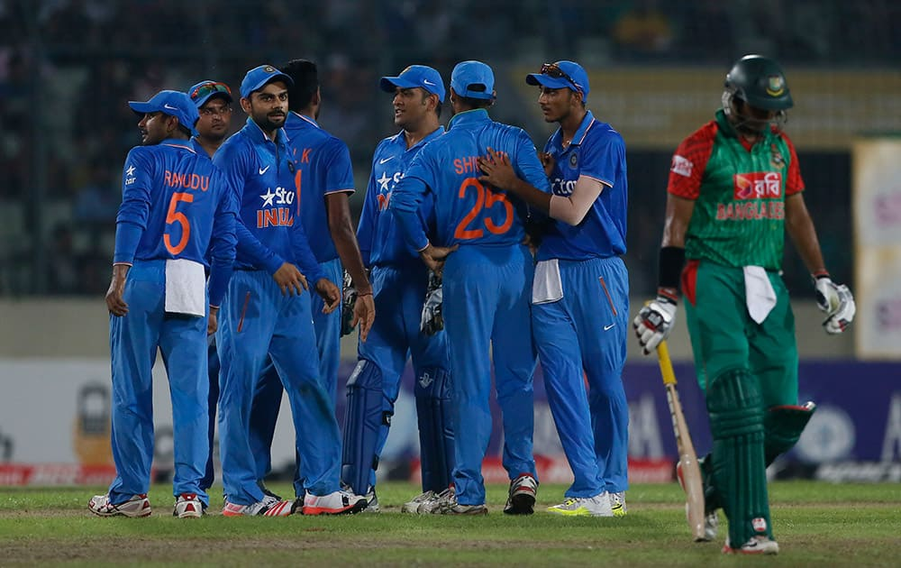 Indian players celebrate the dismissal of Bangladesh's Soumya Sarkar during their third one-day international cricket match in Dhaka.
