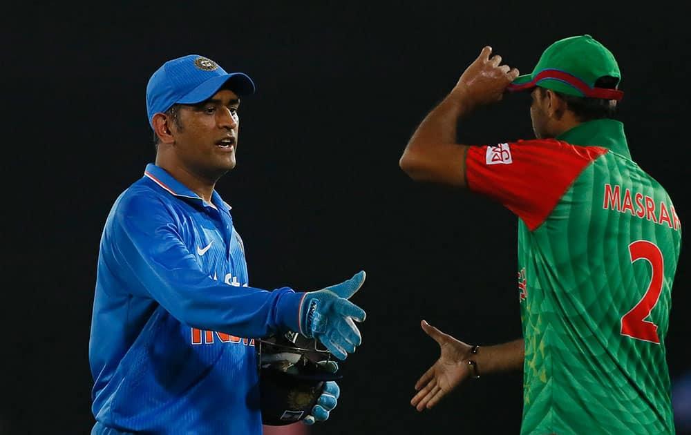 India's captain M S Dhoni, left, greets Bangladesh's captain Mashrafe Mortaza after winning their third one-day international cricket match in Dhaka, Bangladesh.