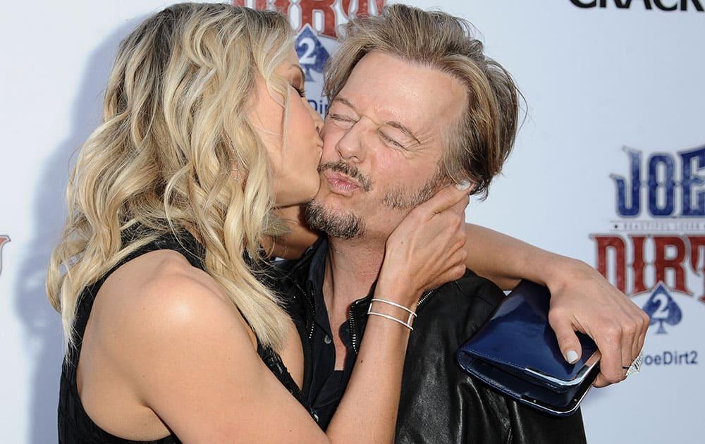 Brittany Daniel and David Spade kiss at the LA Premiere of