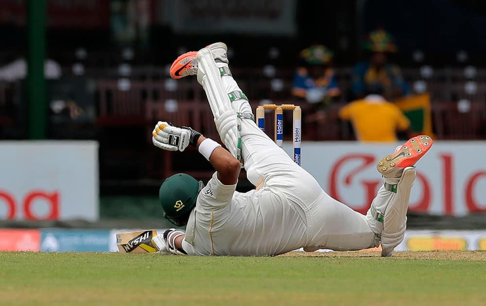 Pakistan's Azhar Ali slips on a wicket during the first day of the second test cricket match against Sri Lanka in Colombo, Sri Lanka.