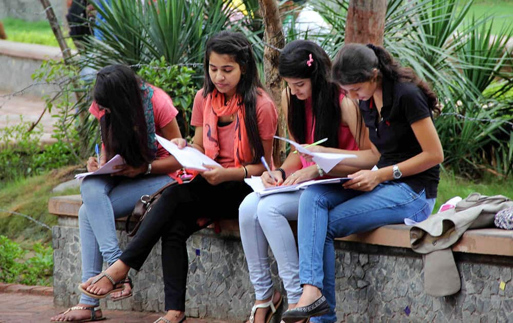 A group of girls filling up their admission forms on the first day of Delhi University admissions at Daulatram College in New Delhi