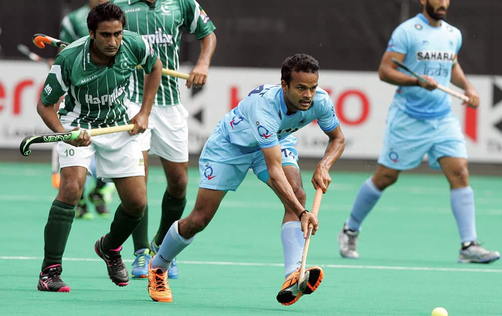 India's Upadhyay Lalit, vies for the ball with Pakistans Rasool Shafqat during the mens Hockey World League semi-finals against Pakistan at the HK Dragon in Brasschaat, Belgium. Twenty countries will compete in the tournament for a qualification ticket for the Olympic Games in Rio in 2016.