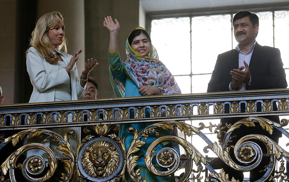 Nobel Peace Prize recipient Malala Yousafzai, waves while introduced at a ceremony for the 70th anniversary of the United Nations in San Francisco.