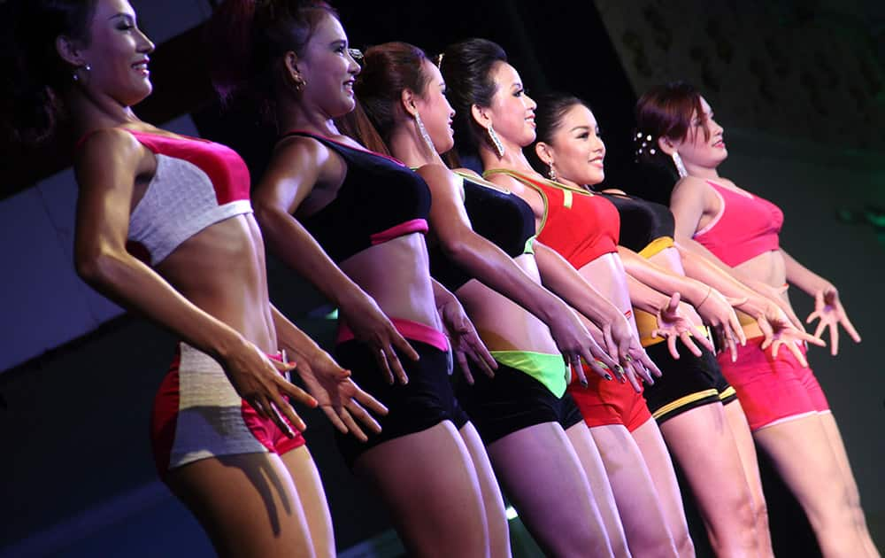 Contestants model during a bodybuilder competition organized by the Myanmar Bodybuilder Federation at the Myanmar Convention Center (MCC) in Yangon, Myanmar.