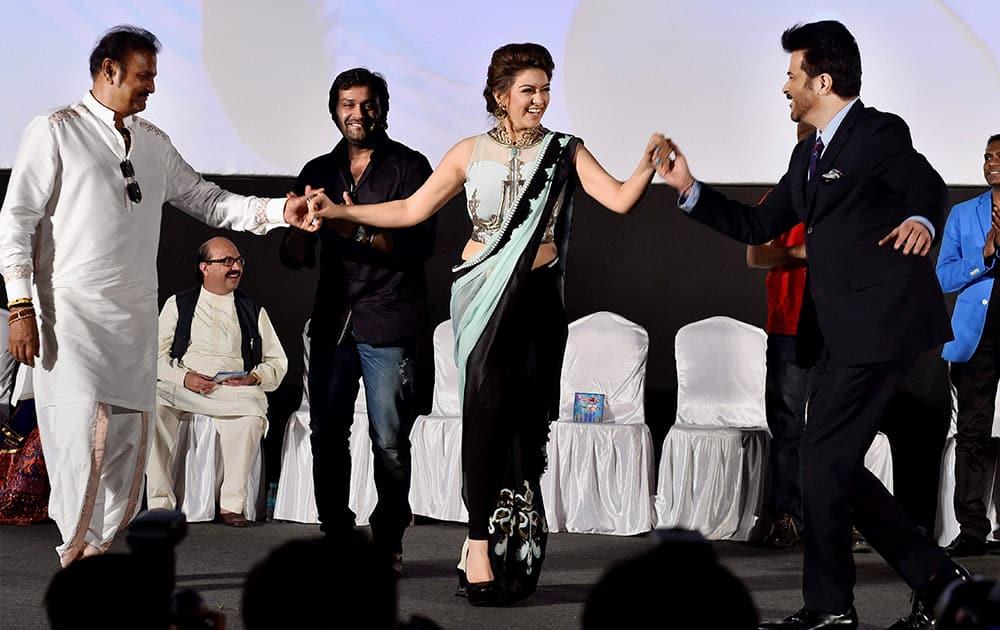 Hansika Motwani dancing with Bollywood actor Anil Kapoor and Telugu actor Mohan Babu at a launch event in Chennai.