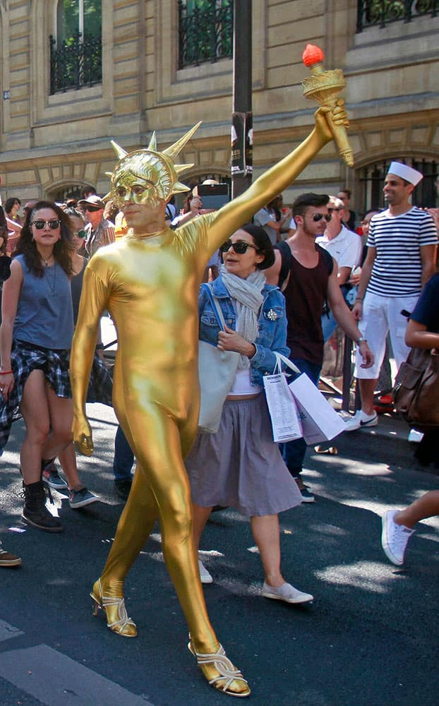A participant in the annual Gay Pride march parades in a street of Paris.