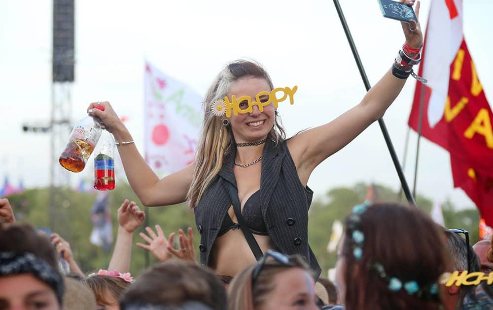 A music lover watches Pharrell Williams during the Glastonbury Music Festival at Worthy Farm, Glastonbury, England.