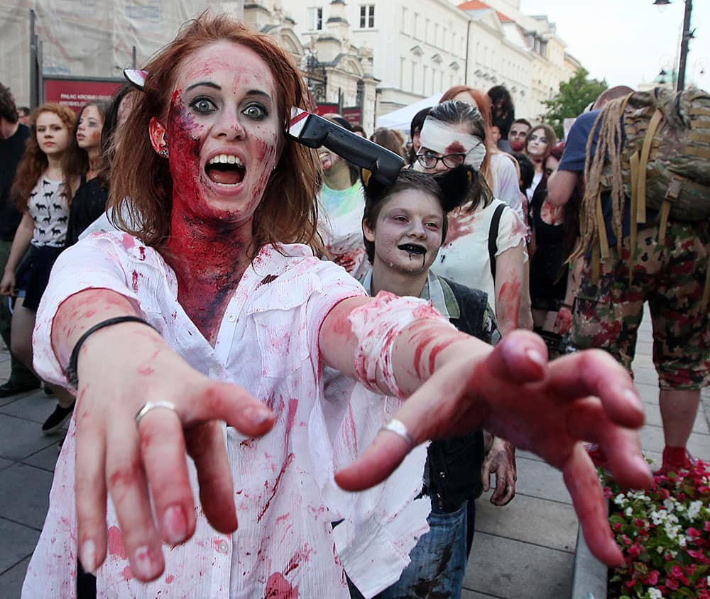 Young people dressed as zombies gather to take part in a Zombie Walk on streets of Warsaw, Poland.