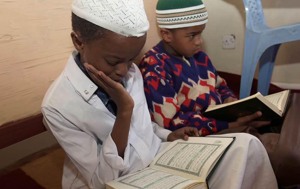 Kenyan Muslim children read verses of Quran, on the 11th day of the Muslim holy month of Ramadan at a Madrassa, in Nairobi, Kenya.