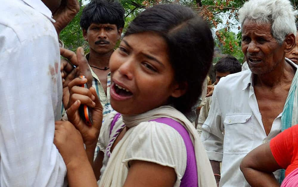 Wailing family members after two students of a residential public school were found dead, in Nirpur village at Nalanda district.