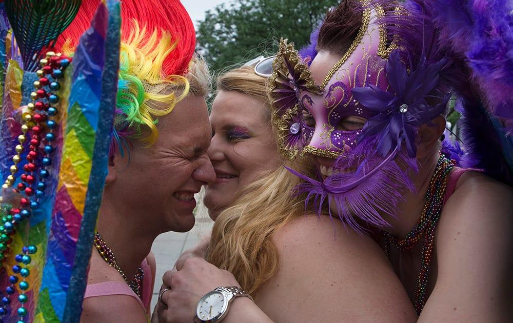 Revelers hug before stepping off during the Cincinnati Pride parade.
