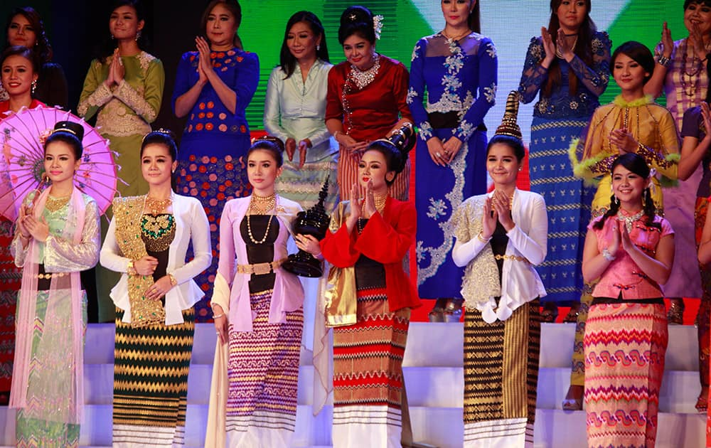 Myanmar models present traditional dresses creation of local designers during a fashion show to mark Myanmar Women Day at the National Theater.