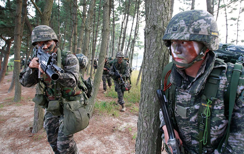 South Korean Marines move after they landed on the beach during a landing exercise in Taean, western South Korea.