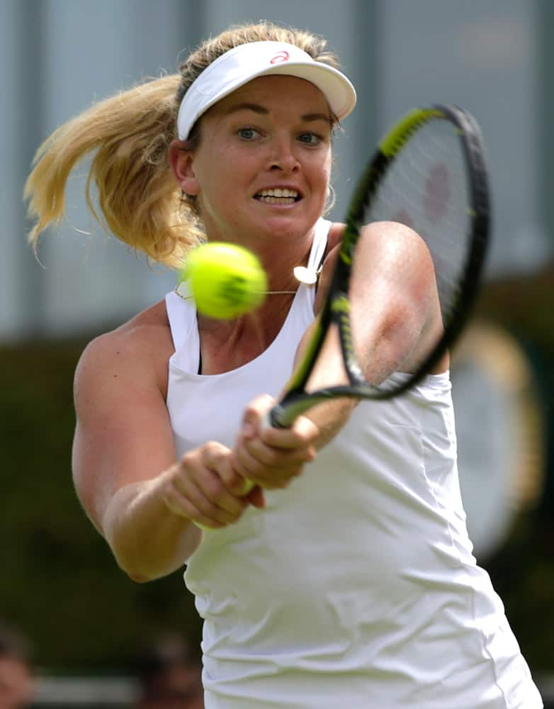 Coco Vandeweghe of the United States returns a ball to Anna Karolina Schmiedlova of Slovakia during the women's singles first round match at the All England Lawn Tennis Championships in Wimbledon, London