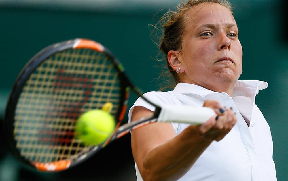 Barbora Strycova of the Czech Republic returns a ball to Sloane Stephens of the United States during the women's singles first round match at the All England Lawn Tennis Championships in Wimbledon, London.