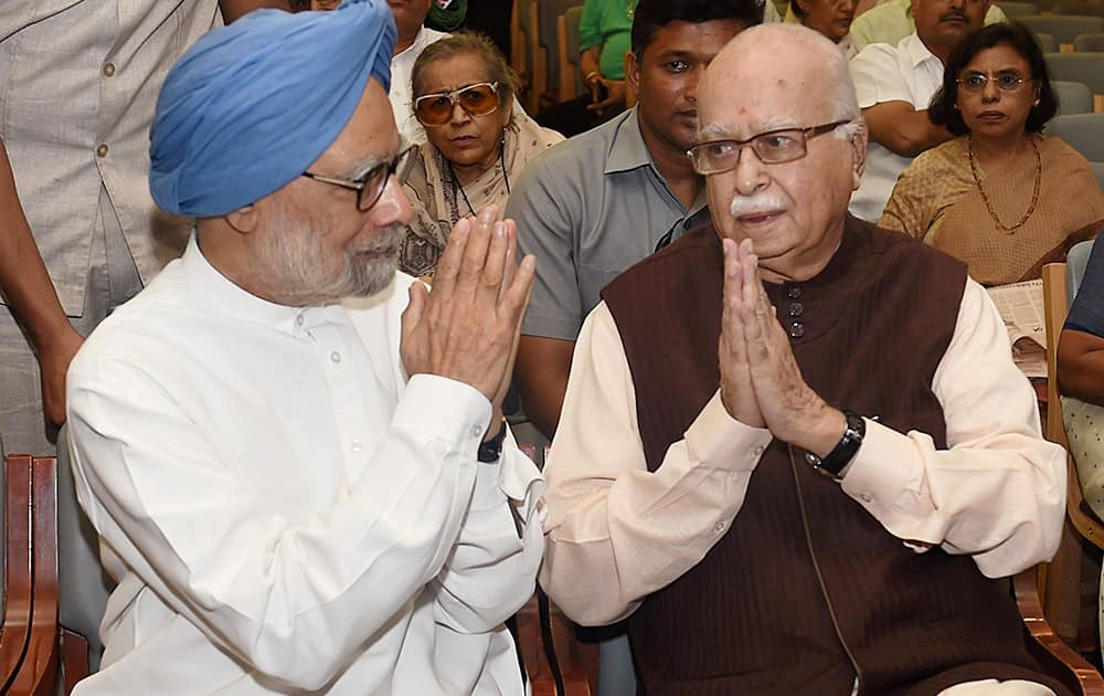 Former Prime Minister Manmohan Singh with BJP Leader L K Advani during the Memorial meeting of former bureaucrat M N Buch in New Delhi.