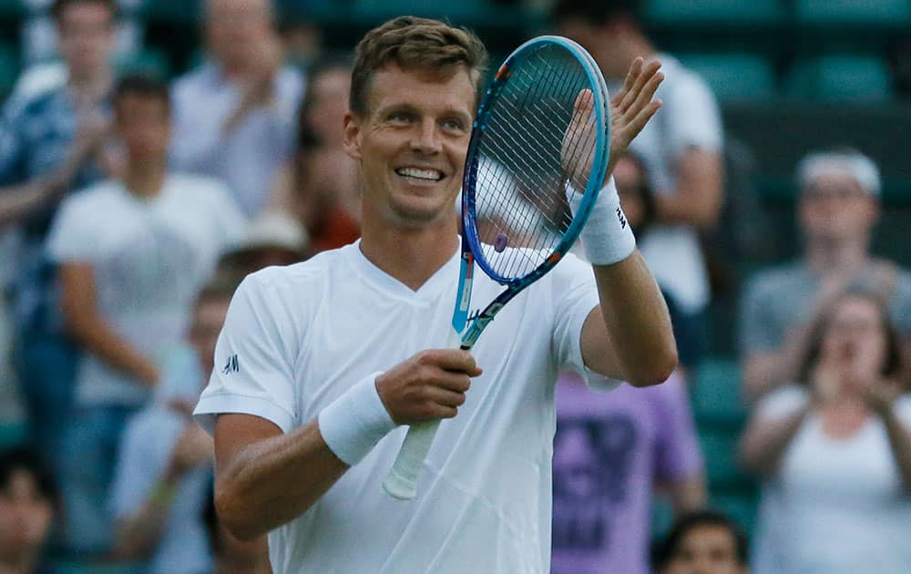 Tomas Berdych of the Czech Republic celebrates defeating Jeremy Chardy of France in the singles first round match at the All England Lawn Tennis Championships in Wimbledon, London.