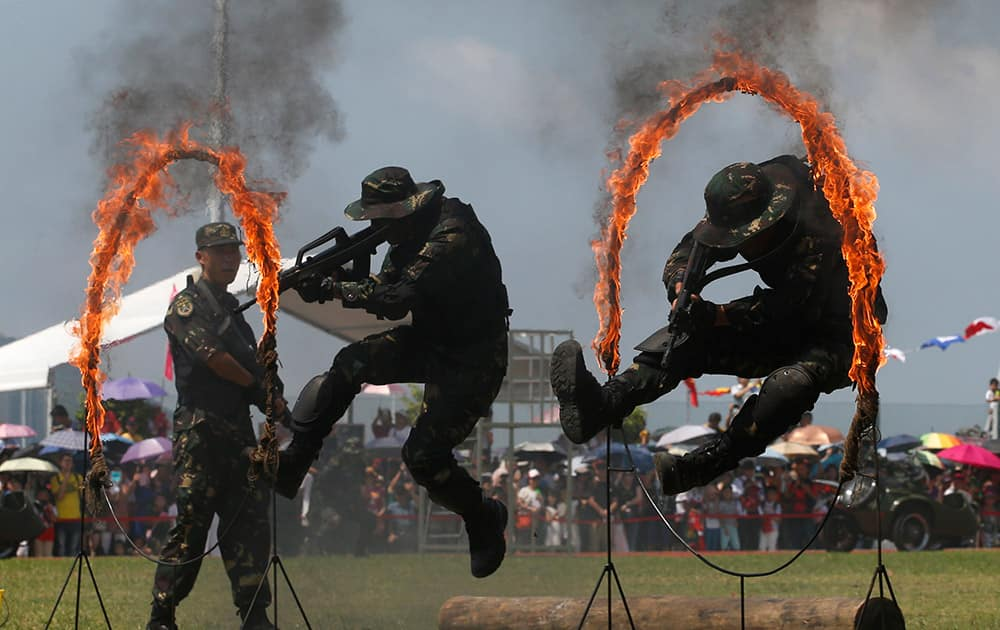 Chinese People's Liberation Army (PLA) personnel demonstrate during the open day of Stonecutter Island Navy Base in Hong Kong to mark the 18th anniversary of the Hong Kong handover to China in Hong Kong.