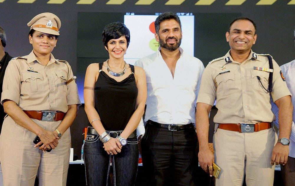 Suneil Shetty with actress Mandira Bedi and Joint Commissioner (Traffic) Milind Bharambe at the launch of Street Smart, Street Safe, a road safety campaign in Mumbai.