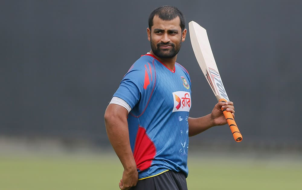 Bangladesh's Tamim Iqbal walks with a bat during a practice session ahead of their first Twenty20 cricket match against South Africa in Dhaka, Bangladesh.