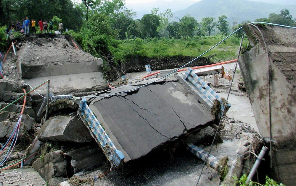 Rathikhola Bridge collapses due to heavy rains in Darjeeling.