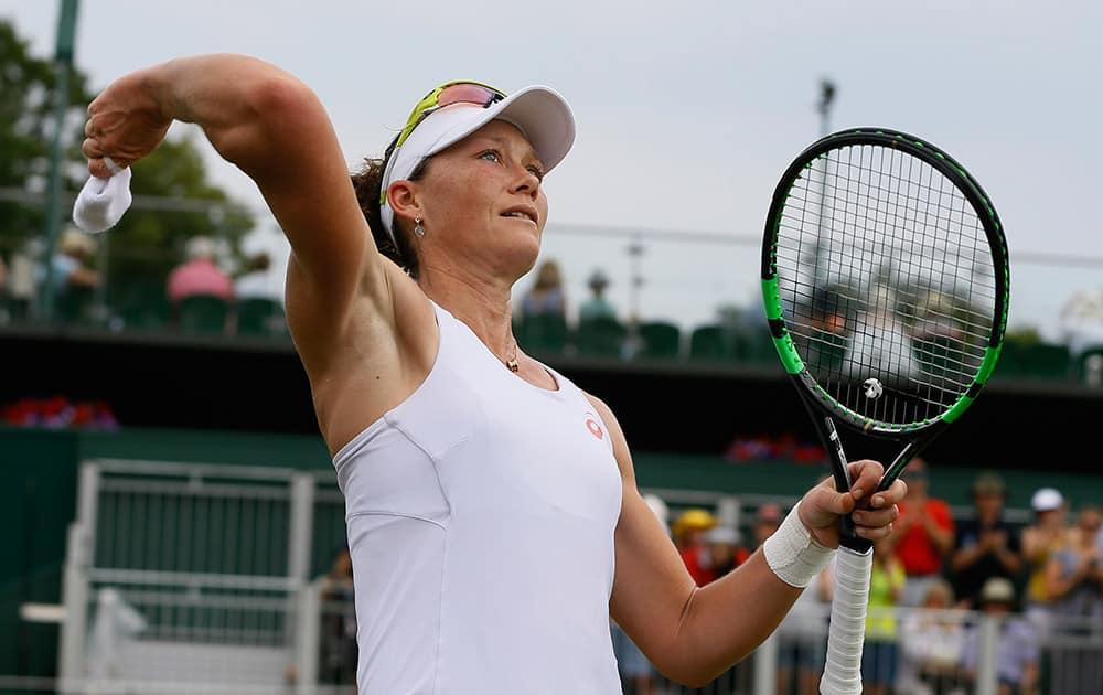 Samantha Stosur of Australia throws a wristband after winning the women's singles match against Urszula Radwanska of Poland, at the All England Lawn Tennis Championships in Wimbledon, London. Stosur won the match 6-3, 6-4.