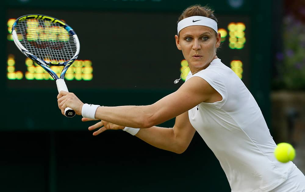 Lucie Safarova of the Czech Republic returns a shot to Su-Wei Hsieh of Taiwan during their singles match at the All England Lawn Tennis Championships in Wimbledon, London.