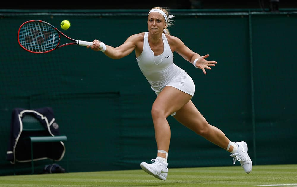 Sabine Lisicki of Germany returns a ball to Christina Mchale of the United States, during their singles match at the All England Lawn Tennis Championships in Wimbledon, London.