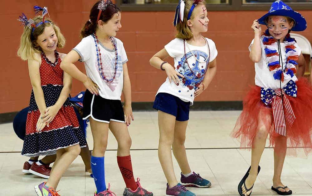Deaconess summer campers, Emma Griffin, Isabelle Bohleber, Molli Sullivan and Zoey Howell strike their best poses for the judges at the Fourth of July costume contest.