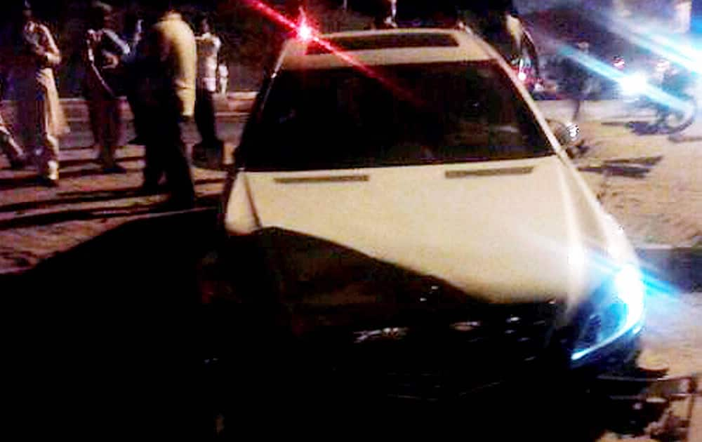 People crowd around the car of veteran actress and BJP MP Hema Malini after it met with an accident in Dausa. Malini sustained injuries in the accident and being rushed to a hospital in Jaipur.