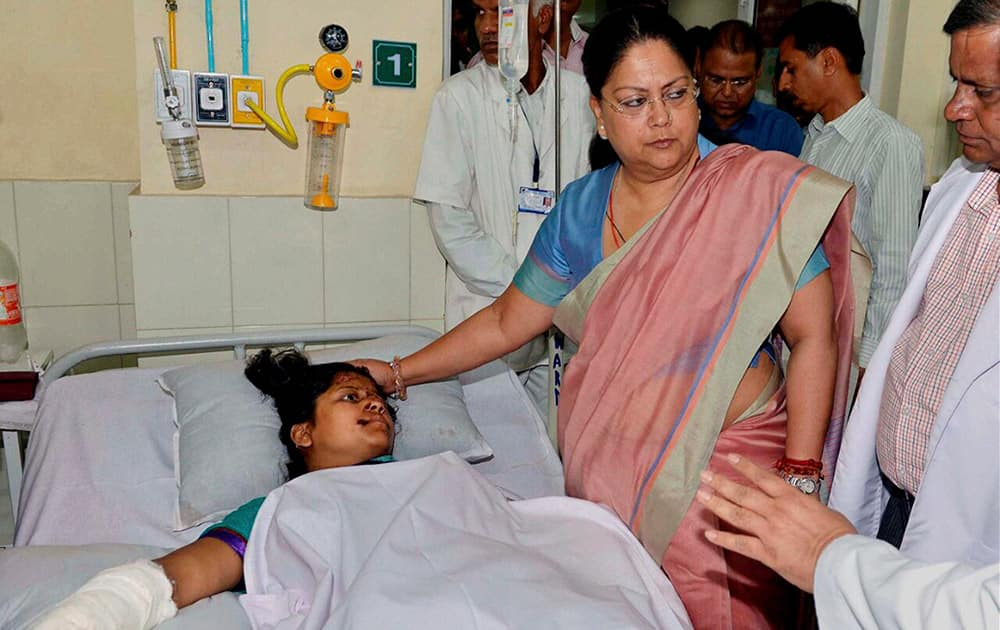 Rajasthan Chief Minister Vasundhara Raje meets with an injured woman undertreatment at a hospital following an accident with Actress & BJP MP Hema Malini's car.
