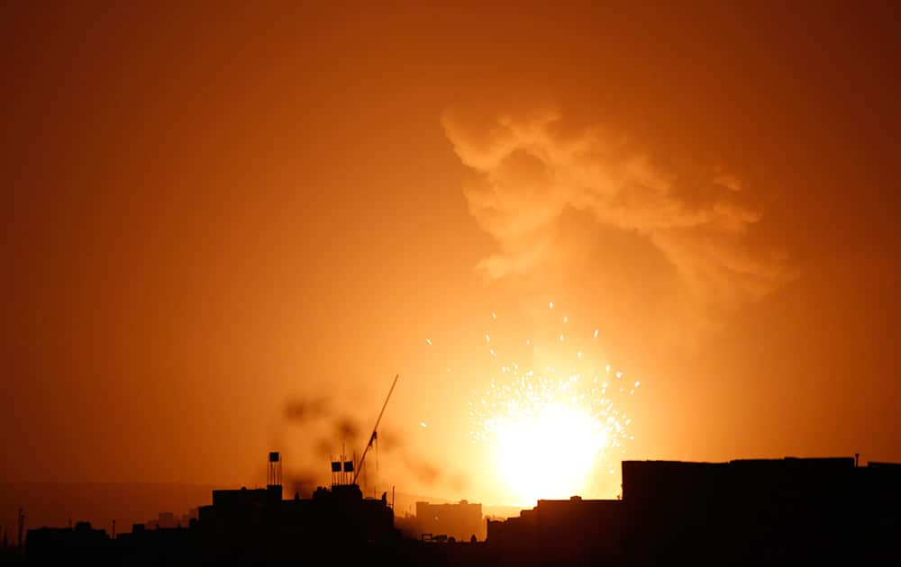Explosion and smoke rises after a Saudi-led airstrike hit a site believed to be one of the largest weapons depot on the outskirts of Yemen's capital, Sanaa.