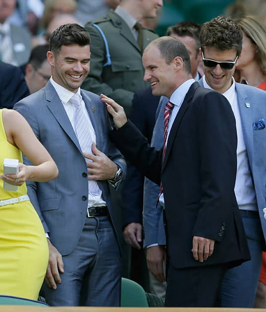 England cricketer James Anderson and Andrew Strauss take their seats in the Royal Box on Centre Court at the All England Lawn Tennis Championships in Wimbledon, London.