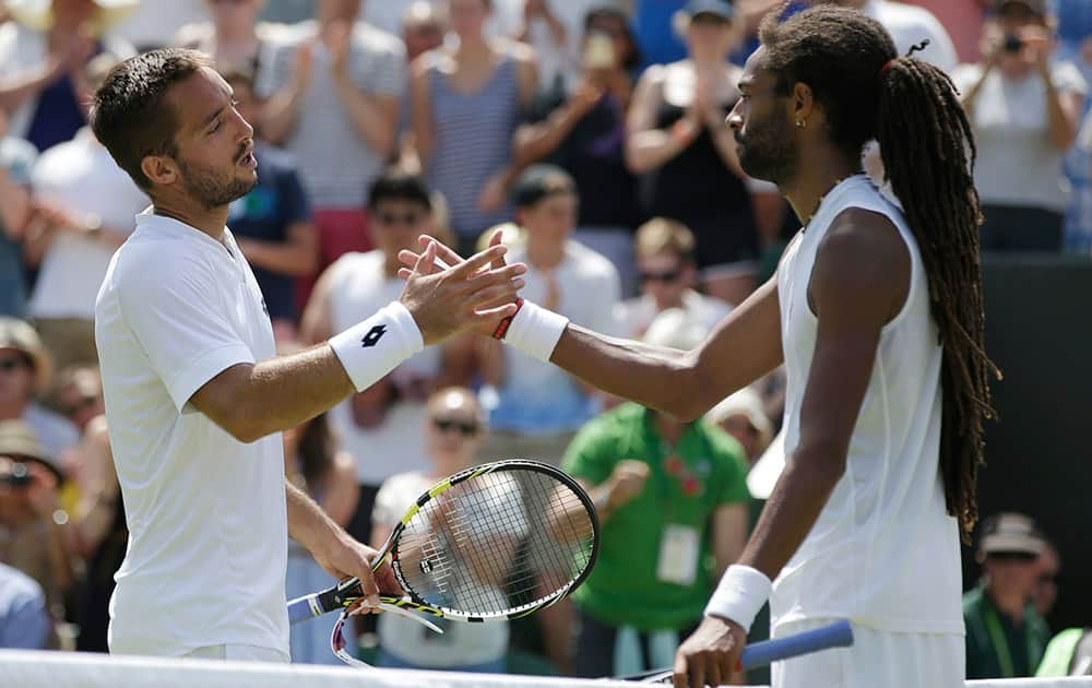 Viktor Troicki of Serbia shakes hands after defeating Dustin Brown of Germany in their singles tennis match at the All England Lawn Tennis Championships in Wimbledon, London. Troicki won the match 6-4, 7-6, 4-6, 6-3.