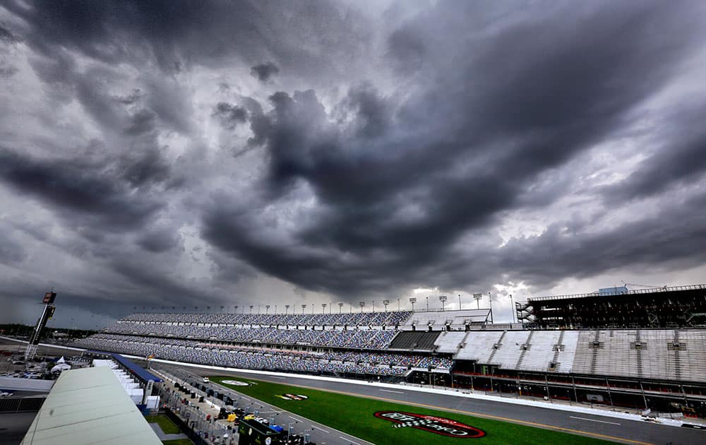 Storms clouds tower over Daytona International Speedway as qualifying for the NASCÅR Sprint Cup auto race was canceled in Daytona Beach, Fla.