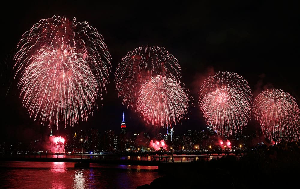 Fireworks explode over the East River in front of the Manhattan skyline as seen from the Brooklyn borough of New York during the Macy's Fourth of July fireworks show.