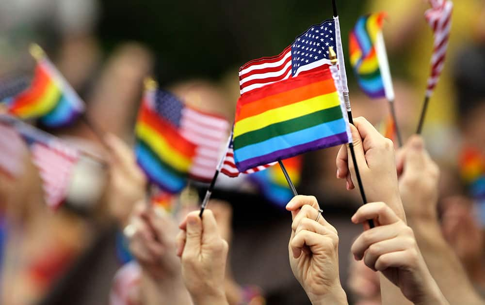 Flags are waved during the National LGBT 50th Anniversary Ceremony, in front of Independence Hall in Philadelphia.