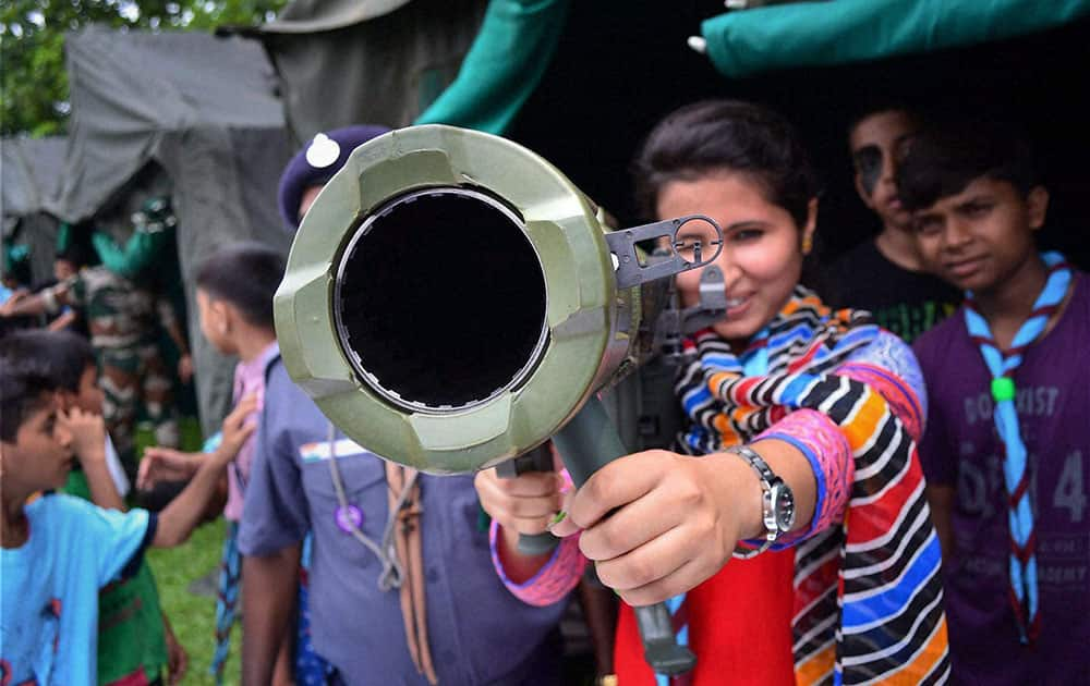 A student having look of a rocket launcher at an exhibition organised by the Indian Army.