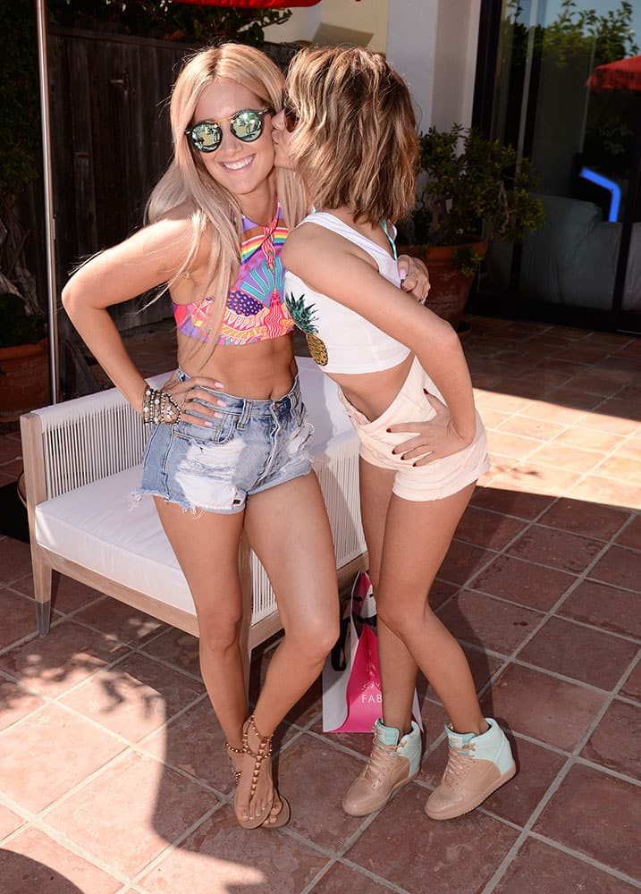 ctress Ashley Tisdale, left, and actress Sarah Hyland celebrate Tisdale's 30th Birthday at the JustFab House Presented by Kia Motors, in Malibu, Calif.