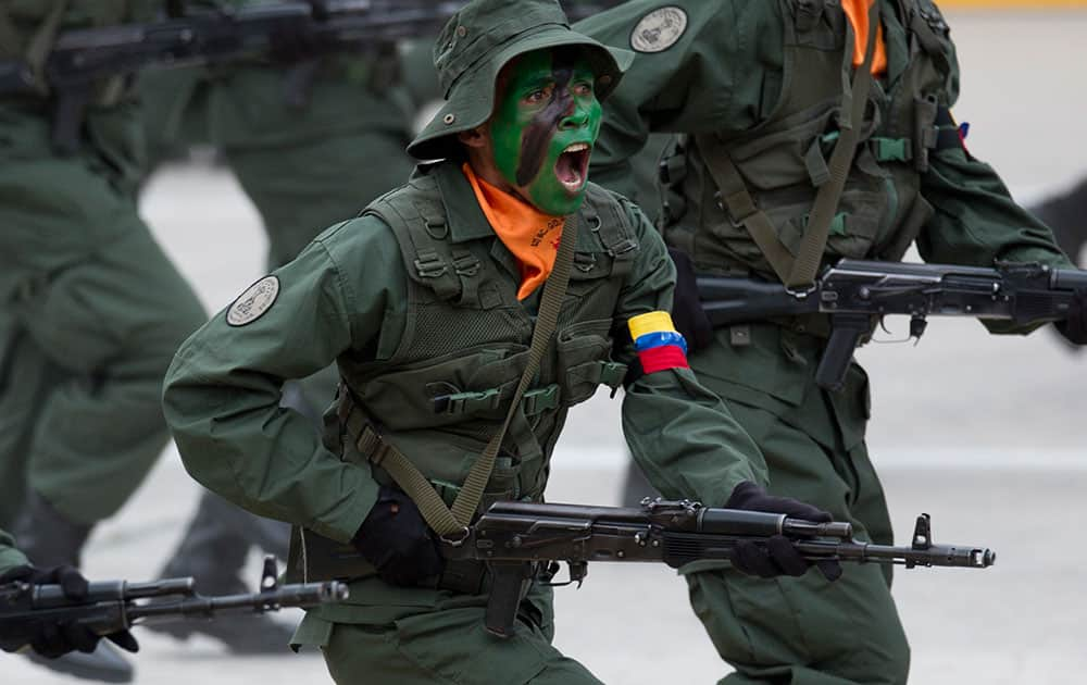 Soldiers march during a parade marking Venezuela's Independence Day in Caracas, Venezuela.