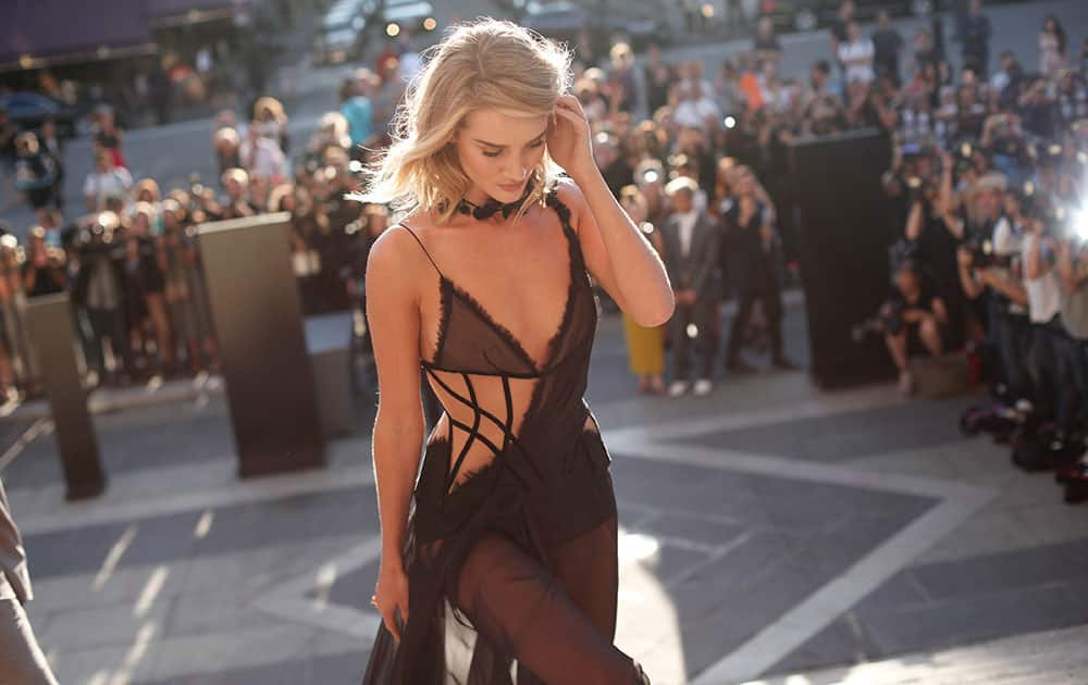 British model and actress Rosie Huntington-Whiteley arrives for the Versace's fall-winter 2015/2016 Haute Couture fashion collection presented in Paris, France.