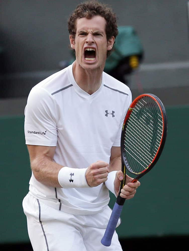 Andy Murray of Britain celebrates after winning a point against Andreas Seppi of Italy during their singles match at the All England Lawn Tennis Championships in Wimbledon, London.