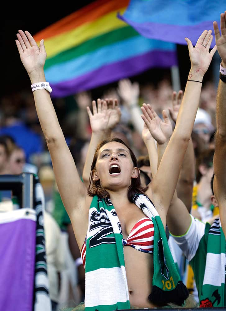 A Portland Timbers fans cheers as the team takes the field before an MLS soccer game against the San Jose Earthquakes in Portland, Ore.