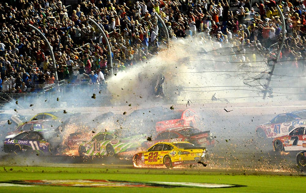 Austin Dillon (3) goes airborne and hits the catch fence as he was involved in a multi-car crash on the final lap of the NASCAR Sprint Cup series auto race at Daytona International Speedway in Daytona Beach, Fla.