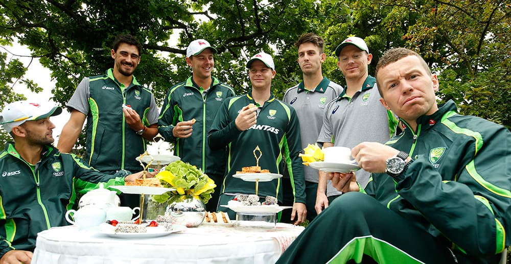 Australian cricketers Nathan Lyon, Mitchel Starc, Josh Hazlewood, Steve Smith, Mitchel March, George Bailey and Peter Siddle, pose for the TV and photographers during a media event in London.
