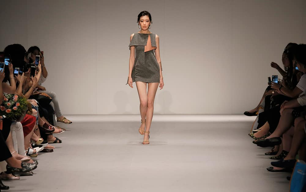 A model presents a creation by Hong Kong fashion brand Lagerose during the Spring/Summer fashion week in Hong Kong.