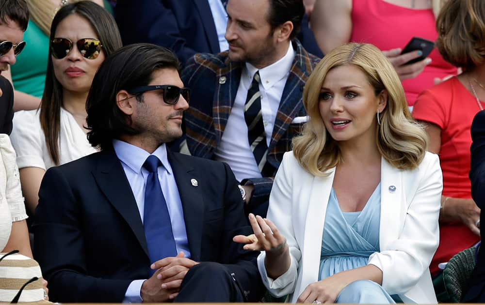 British singer Katherine Jenkins, right and her husband Andrew Jonathan Levitas sit in the Royal Box on Centre Court, at the All England Lawn Tennis Championships in Wimbledon.