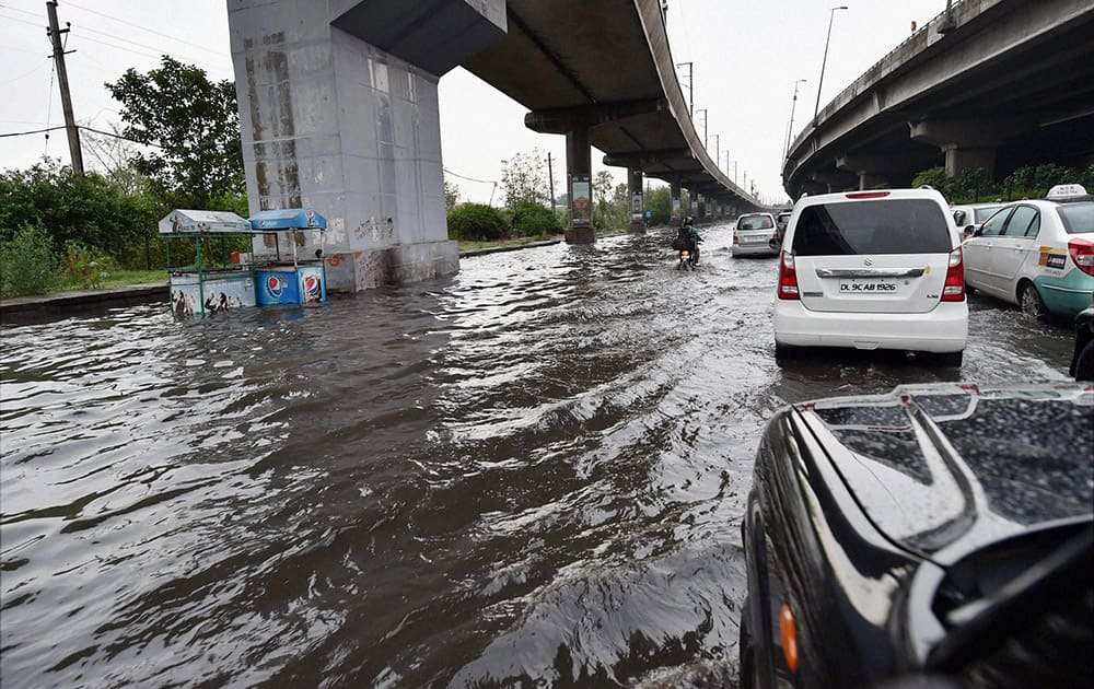 Water logging at a road after heavy rains in New Delhi.